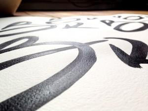 Création à l'encre de chine et réalisation du logo